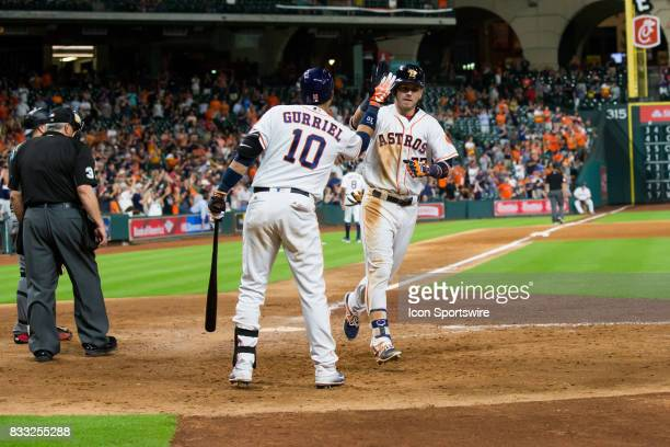 Houston Astros right fielder Josh Reddick shakes hands with Houston Astros first baseman Yuli Gurriel after hitting a homerun in the eighth inning of...
