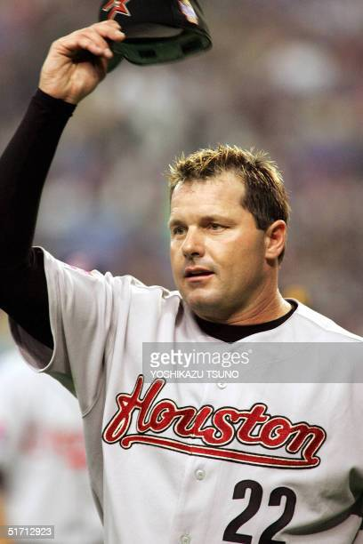 Houston Astros' Roger Clemens reacts to the audience before starting a friendly match between the Major League Baseball selected team and Japanese...