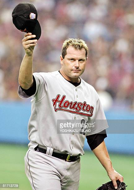 Houston Astros' Roger Clemens waves his cap to the audience as he leaves the pitching mound during the friendly match between the Major League...