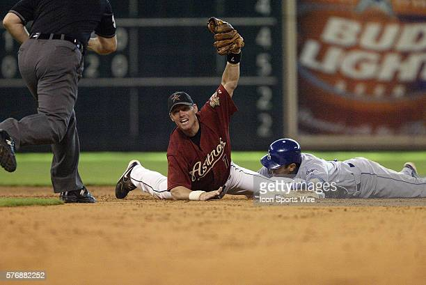 Houston Astros second baseman Craig Biggio tags out Los Angeles Dodgers shortstop Oscar Robles in the ninth inning of the Los Angeles Dodgers vs...