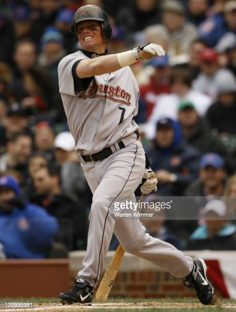 Houston Astros second baseman Craig Biggio takes a big cut at a Ted Lilly offering during game action at the season home opener of the Chicago Cubs...