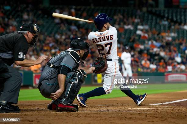 Houston Astros second baseman Jose Altuve reacts after hitting the ball for a single in the third inning of a MLB game between the Houston Astros and...