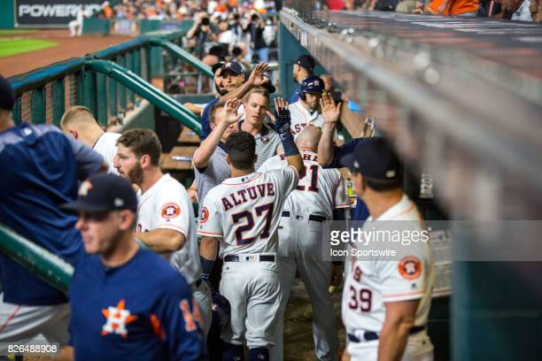 Houston Astros second baseman Jose Altuve shakes hands with teammates after hitting a solo home run in the third inning of the MLB game between the...