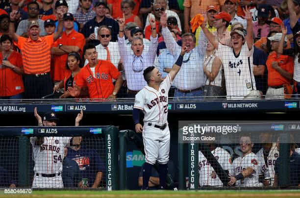 Houston Astros second baseman Jose Altuve takes a curtain call after his third home run of the game in the seventh inning The Houston Astros host the...