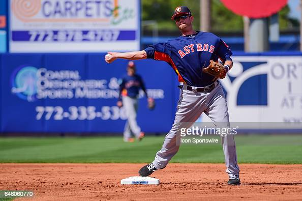 Houston Astros short stop Reid Brignac turns a double play during a Spring Training game between the Houston Astros and New York Mets on February 27...