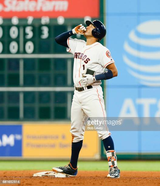 Houston Astros shortstop Carlos Correa celebrates after hitting a double in the seventh inning against the Atlanta Braves at Minute Maid Park on May...