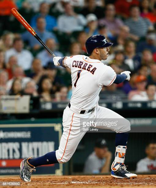 Houston Astros shortstop Carlos Correa doubles in the fifth inning against the Atlanta Braves at Minute Maid Park on May 10 2017 in Houston Texas