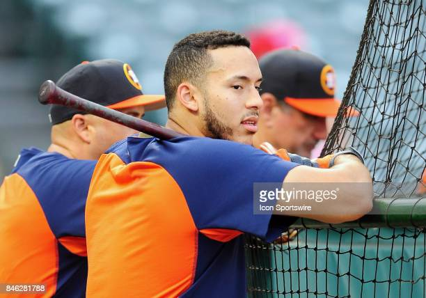 Houston Astros shortstop Carlos Correa leans on the batting cage during batting practice before a game against the Los Angeles Angels of Anaheim on...