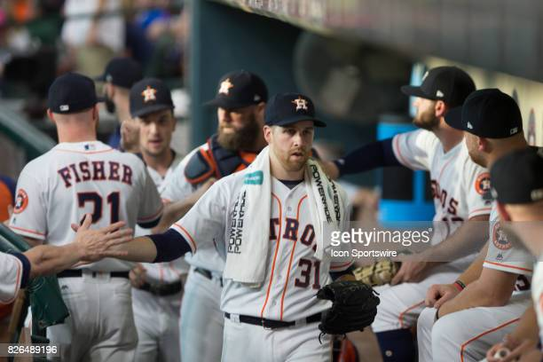 Houston Astros starting pitcher Collin McHugh shakes hands in the first inning of the MLB game between the Houston Astros and the Tampa Bay Rays at...