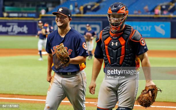 Houston Astros third baseman JD Davis smiles after getting the ball from Houston Astros catcher Evan Gattis following his strike out pitching to end...