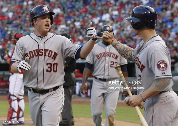 Houston Astros third baseman Matt Dominguez is greeted at home plate by center fielder Brandon Barnes after his tworun homer during the second inning...