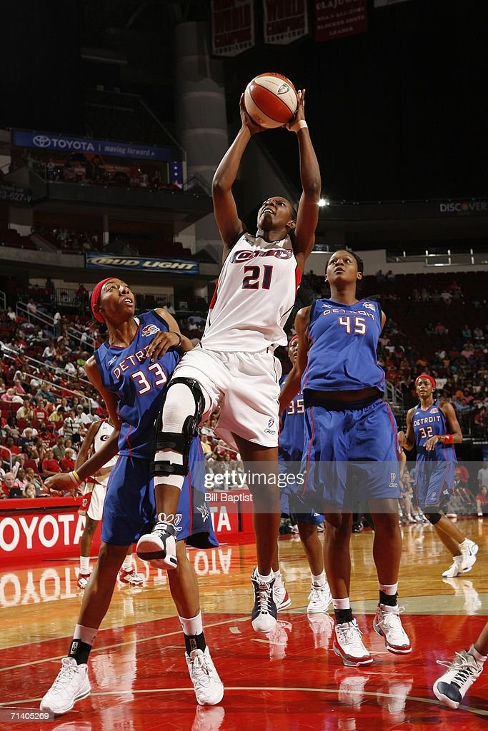Houston Comets forward Sancho Lyttle shoots over Detroit Shocks Angelina Williams during their game July 9 2006 at the Toyota Center in Houston Texas...