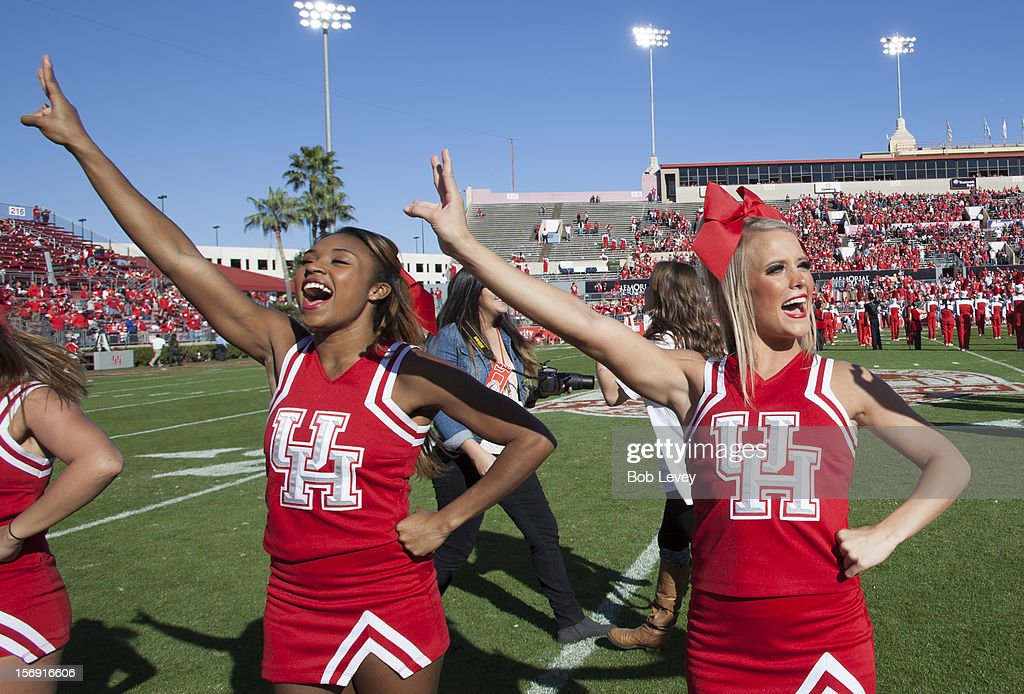 Houston Cougars cheerleaders get the crowd going against the Tulane Green Wave at Robertson Stadium on November 24, 2012 in Houston, Texas. Houston defeats Tulane 40-17.