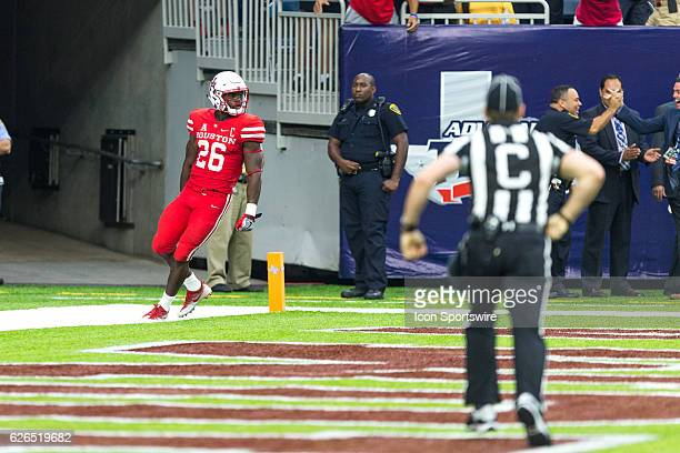 Houston Cougars cornerback Brandon Wilson react after his kick return for a touchdown in the second half of action during a Advocare Texas Kickoff...
