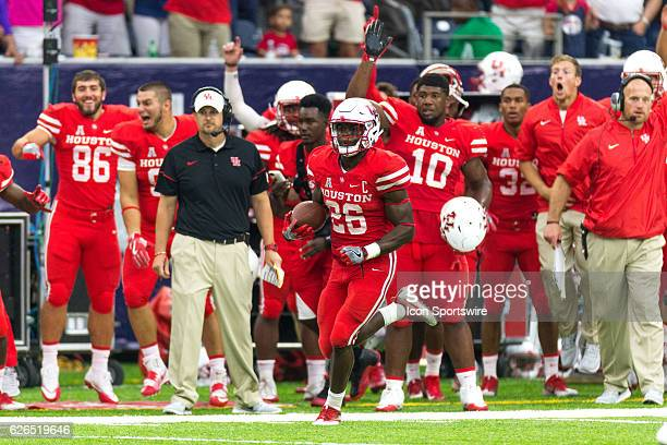 Houston Cougars cornerback Brandon Wilson returns the ball for a touchdown in the second half of action during a Advocare Texas Kickoff football game...