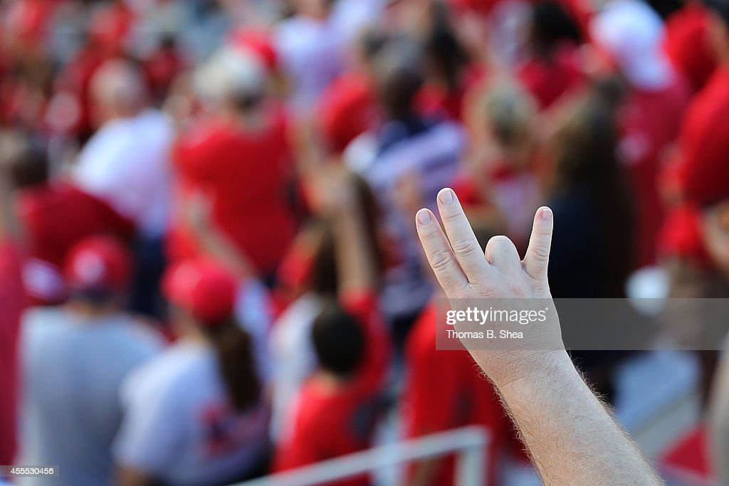 A Houston Cougars fan sings the Houston Cougars song before the Cougars played against the Grambling State Tigers on September 6, 2014 at TDECU Stadium in Houston, Texas.