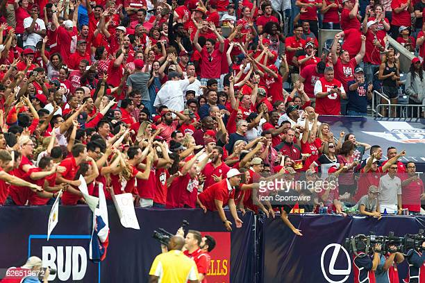 Houston Cougars fans celebrate on Brandon Wilson kick return for a touchdown in the second half of action during a Advocare Texas Kickoff football...