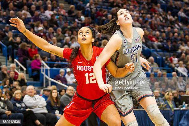 Houston Cougar's Forward Brianne Coffman and UConn Huskies Center Natalie Butler under the basket during the first half a women's NCAA division 1...