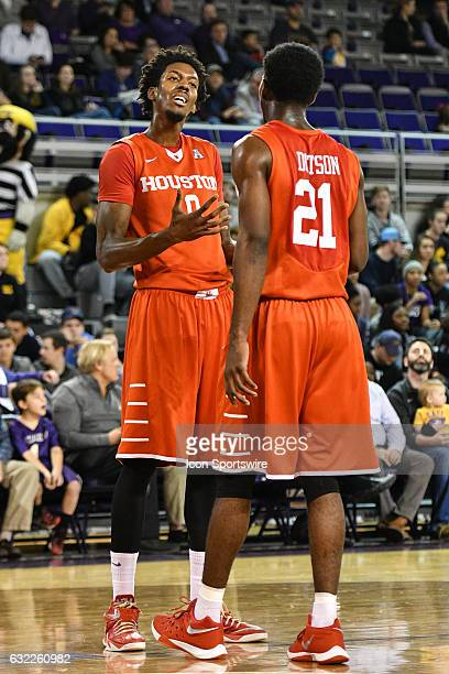 Houston Cougars forward Danrad Knowles and Houston Cougars guard Damyean Dotson talk during a timeout in an American Athletic Conference game between...