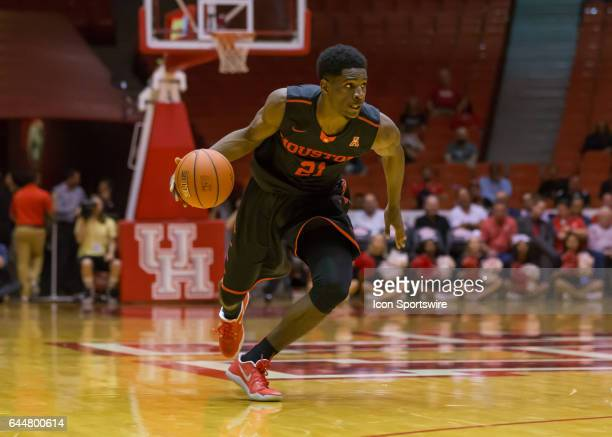 Houston Cougars guard Damyean Dotson brings the ball up the court during the Men's basketball game between the UConn Huskies and Houston Cougars on...