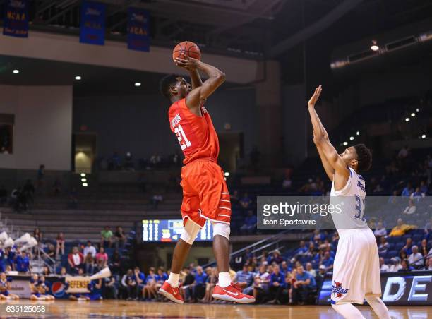 Houston Cougars Guard Damyean Dotson elevates his shot over Tulsa Golden Hurricane Guard Corey Henderson Jr during the AAC Mens basketball game...