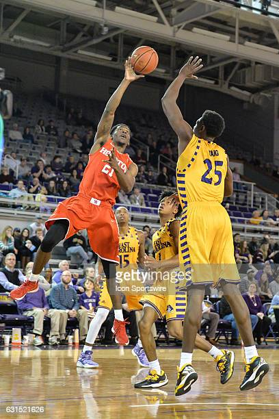 Houston Cougars guard Damyean Dotson gets a shot off over East Carolina Pirates forward Jabari Craig in an American Athletic Conference game between...