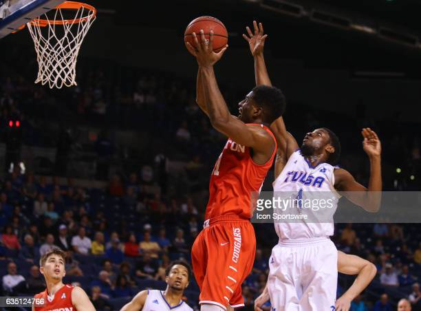 Houston Cougars Guard Damyean Dotson gets high for the short lay in score during the AAC Mens basketball game between the Houston Cougars and the...