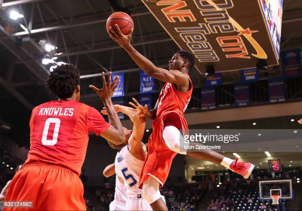 Houston Cougars Guard Damyean Dotson goes over Tulsa Golden Hurricane Guard Lawson Korita for the finger roll during the AAC Mens basketball game...
