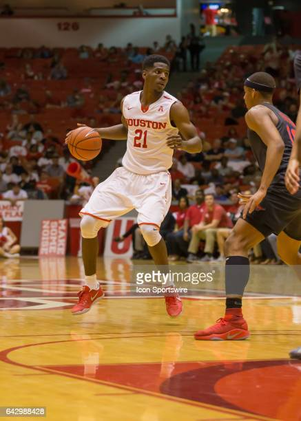 Houston Cougars guard Damyean Dotson looks for an open player during the Men's basketball game between the Southern Methodist Mustangs and Houston...