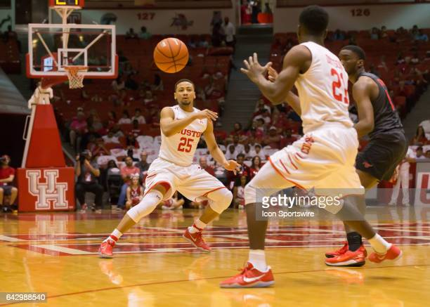 Houston Cougars guard Galen Robinson Jr passes the ball to Houston Cougars guard Damyean Dotson during the Men's basketball game between the Southern...