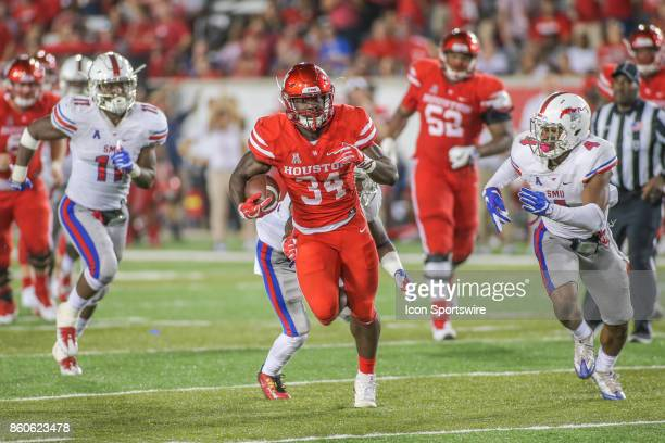 Houston Cougars running back Mulbah Car breaks through the line during the game between SMU and Houston on October 7 at TDECU Stadium in Houston TX