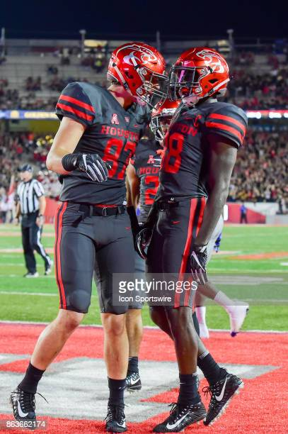 Houston Cougars tight end Alex Leslie celebrates a pass reception to the 1 yard line by Houston Cougars wide receiver Steven Dunbar during the...