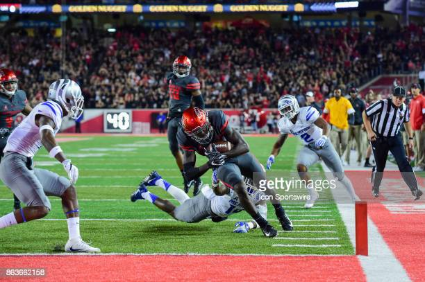 Houston Cougars wide receiver Steven Dunbar is tackled at the 1 yard line by Memphis Tigers defensive back Jonathan Cook during the football game...