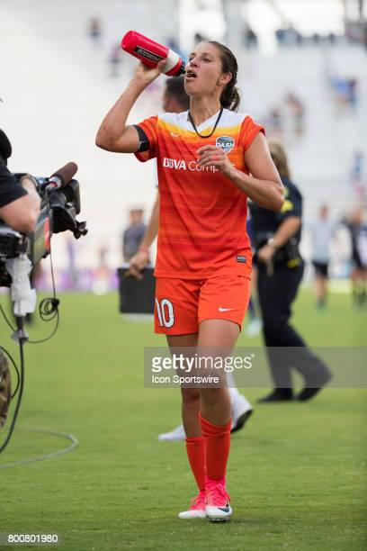 Houston Dash forward Carli Lloyd walks off the pitch at halftime during the NWSL soccer match between the Houston Dash and Orlando Pride on June 24...