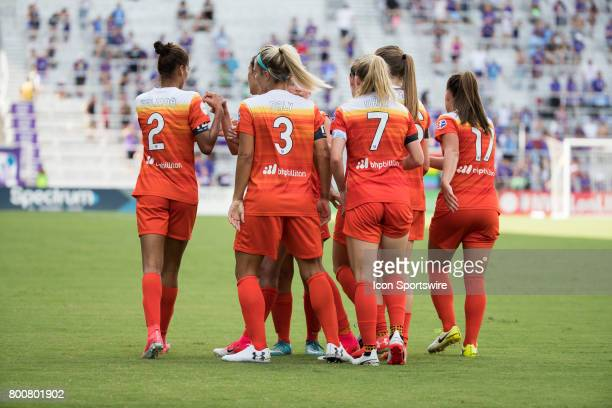 Houston Dash players congratulate Houston Dash forward Rachel Daly after she scored a goal during the NWSL soccer match between the Houston Dash and...