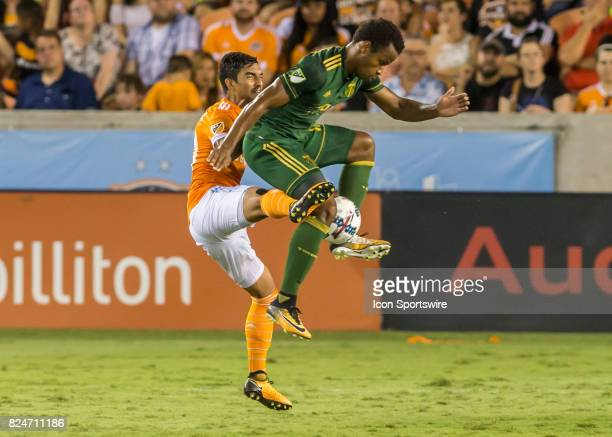 Houston Dynamo defender A J DeLaGarza attempts to kick the ball away from Portland Timbers forward Jeremy Ebobisse during the MLS match between the...
