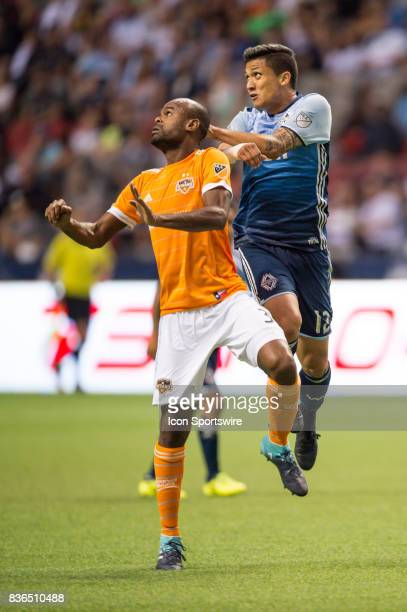Houston Dynamo defender Adolfo Machado and Vancouver Whitecaps forward Fredy Montero jump for the ball during their match at BC Place on August 19...