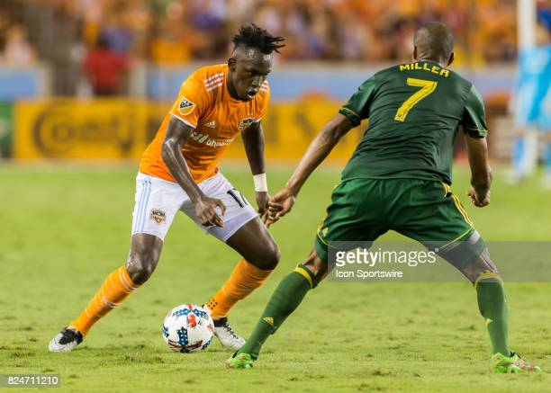 Houston Dynamo forward Alberth Elis attempts to get the ball past Portland Timbers defender Roy Miller during the MLS match between the Portland...