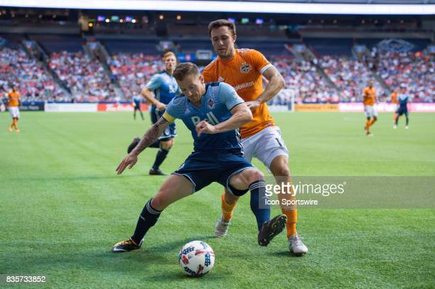 Houston Dynamo forward Andrew Wenger defends against Vancouver Whitecaps defender Jordan Harvey during their match at BC Place on August 19 2017 in...