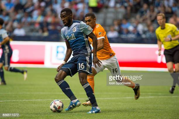 Houston Dynamo forward Mauro Manotas chases Vancouver Whitecaps midfielder Tony Tchani during their match at BC Place on August 19 2017 in Vancouver...