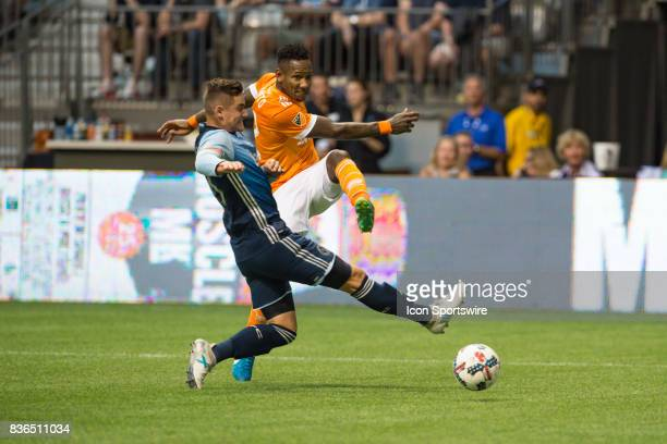 Houston Dynamo forward Romell Quioto kicks the ball past Vancouver Whitecaps defender Jake Nerwinski during their match at BC Place on August 19 2017...