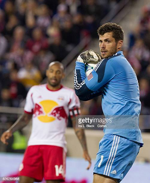 Houston Dynamo Goalkeeper Tally Hall stops the advance of NY Red Bulls while NY Red Bulls Captain Thierry Henry reacts in the background during the...