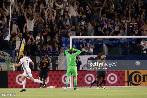 Houston Dynamo goalkeeper Tyler Deric shows frustration after Los Angeles Galaxy midfielder Ema Boateng scores a goal during the game between the LA...