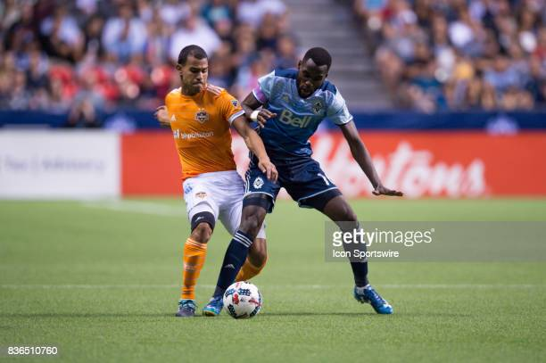 Houston Dynamo midfielder Juan Cabezas defends against Vancouver Whitecaps midfielder Tony Tchani during their match at BC Place on August 19 2017 in...
