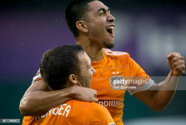 Houston Dynamo midfielder Memo Rodriguez with forward Andrew Wenger after the second goal during a MLS match between DC United and the Houston Dynamo...