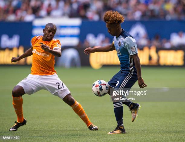 Houston Dynamo midfielder Oscar Garcia defends against Vancouver Whitecaps forward Yordi Reyna during their match at BC Place on August 19 2017 in...