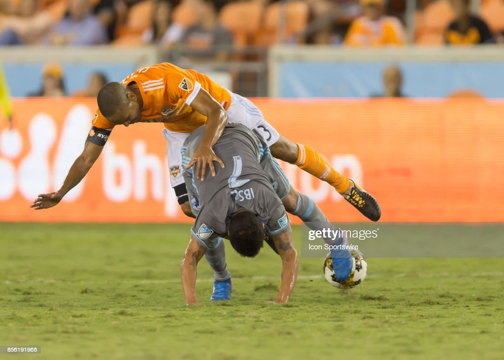 Houston Dynamo midfielder Ricardo Clark (13) flips over Minnesota United midfielder Ibson (7) during the MLS match between the Minnesota United FC and Houston Dynamo on September 30, 2017 at BBVA Compass Stadium in Houston, Texas.