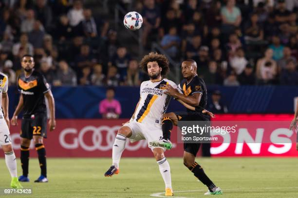 Houston Dynamo midfielder Ricardo Clark tries to defend Los Angeles Galaxy midfielder Joao Pedro during the game between the LA Galaxy and the...