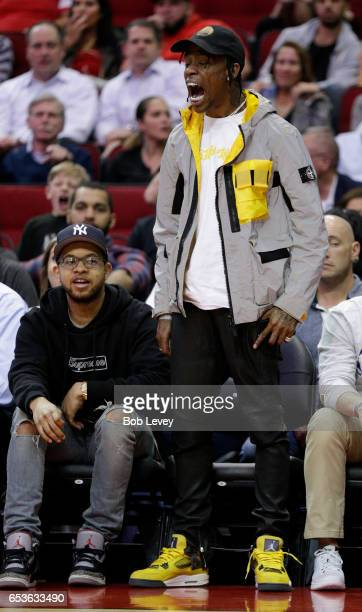 Houston rapper Travis Scott reacts during the fourth quarter at Toyota Center on March 15 2017 in Houston Texas NOTE TO USER User expressly...