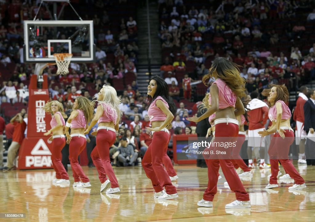Houston Rocket dancers performs during a timeout in a preseason NBA game between the Houston Rockets and the New Orleans Pelicans on October 5, 2013 at Toyota Center in Houston, Texas. The Pelicans won 116 to 115.